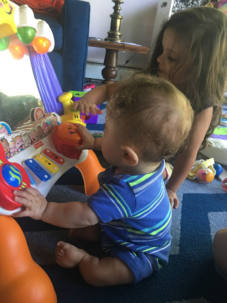 Toy to help baby sit up and play